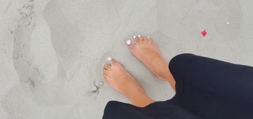 Voeten in het zand